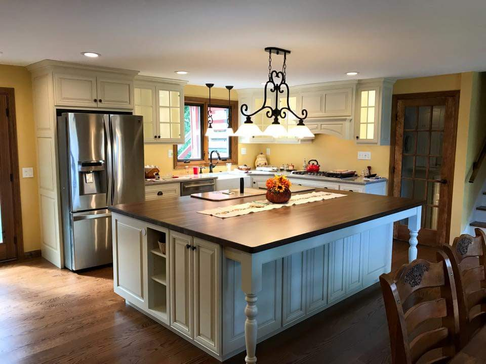 Custom Kitchen Island painted Antique White with Chocolate Glaze and a Dark Walnut Countertop.